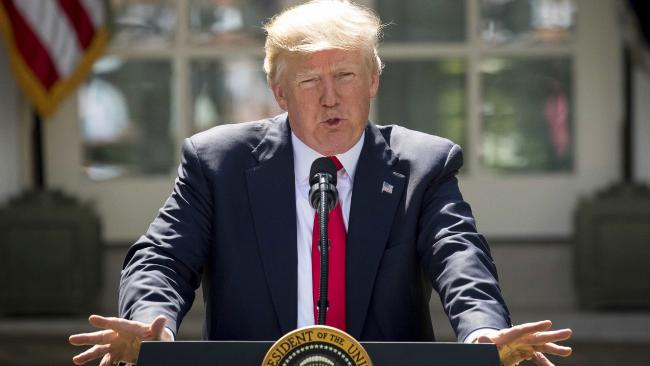 President Donald Trump speaks about the US role in the Paris climate change accord.